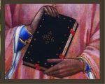 Black book being held with 2 HANDS